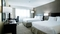 Hilton Nashville Airport - The standard room with two queen beds includes a flat screen TV, free WIFI, mini refrigerator, and coffee maker.