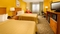 Quality Inn Miami Airport - Spacious room with two double beds.