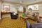 Candlewood Suites - Relax in the hotel lobby while waiting on your transfers to the airport.