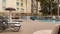 Hilton Garden Inn Orlando Airport - Enjoy the outdoor pool with a kid splash zone to start vacation early.