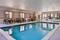 Country Inn & Suites RDU Airport - Relax and unwind in the spacious, heated indoor pool.