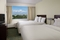 SpringHill Suites Ft. Lauderdale Airport and Cruise Port - The standard room with 2 queen beds has a separate living room with a sleeper sofa, a microwave, and refrigerator.