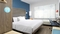 Tru by Hilton Denver Airport 7 DAYS PARKING - The standard, spacious king room includes free WIFI, mini refrigerator and flat screen TV.