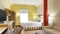 Home2 Suites Charlotte Airport - The standard, spacious queen room includes a sleeper sofa and fully equipped kitchen