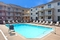 Holiday Inn Express & Suites Pittsburgh Airport - Enjoy time with family and friends in the outdoor pool.