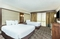 Embassy Suites Nashville Airport - The standard room with 2 double beds has a separate living room with a sleeper sofa, TV, a microwave, and refrigerator.